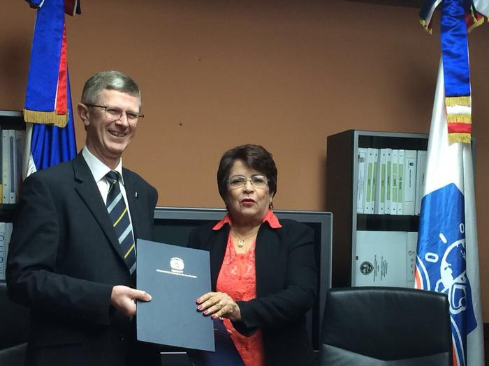 The signing of the MESCYT student scholarship agreement with Minister Dr Alejandrina Germán