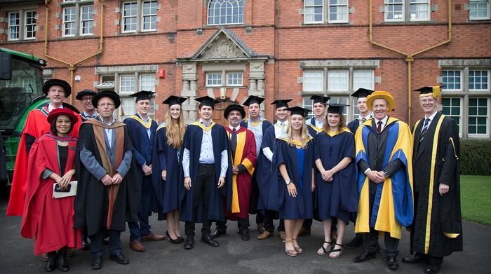 The international graduates with academic staff and graduation VIP Adam Henson