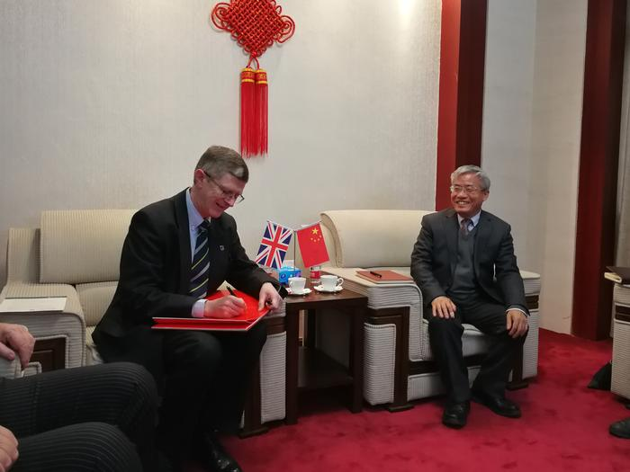 The Vice-Chancellor signing the book of celebration for the 120th anniversary of Huazhong Agricultural University, with Vice-President, Professor Zhang Xianlong
