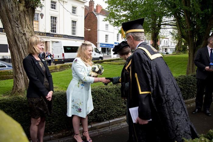 SU Chairman Jessica Spencer present a posy to the Chancellor