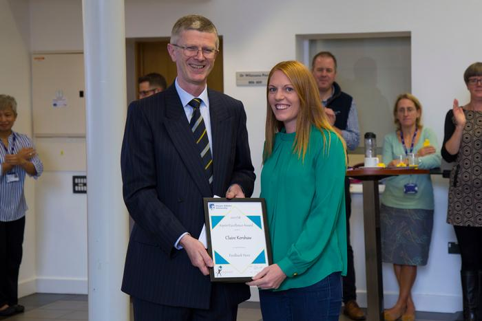 Claire Kershaw receiving her Feedback Hero award