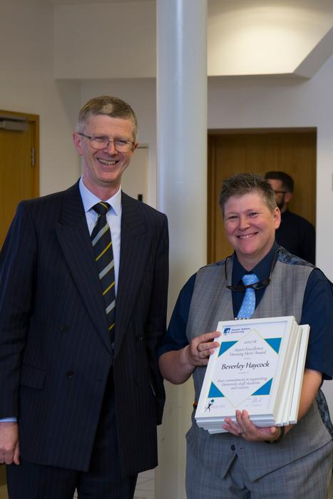 Lavinia Moroz-Hale picking-up the Unsung Hero (team award) on behalf of the reprograhics/reception team