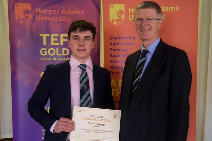 Rory is congratulated by university Vice-Chancellor Dr David Llewellyn