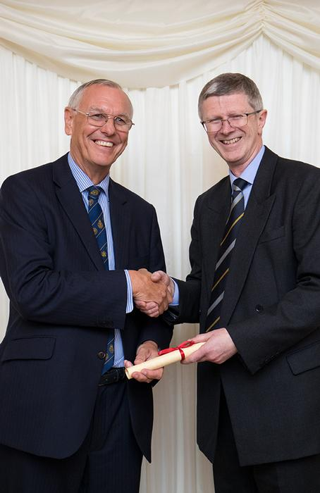 Dr David Llewellyn receives his award from President of the Royal Agricultural Society of England, Jim Godfrey