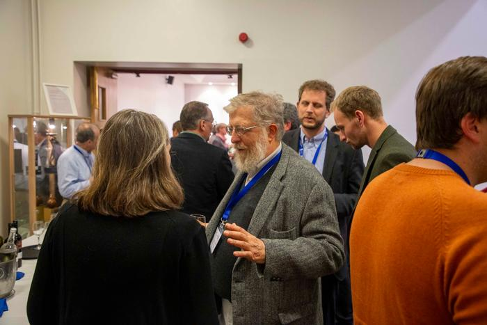 Professor James Lowenberg-BeDoer speaks with guests at the launch dinner