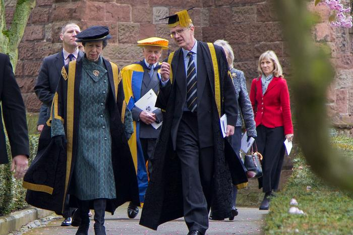 HRH The Princess Royal and man, both in ceremonial robes and mortar board caps