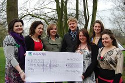 Kate Roberts, RABI Regional Officer, receives the cheque from students that organised the event.
