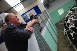 Jim Paice views the rotary parlour.