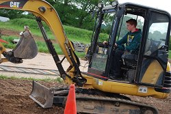 One of the students gets to grips with a digger