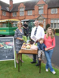 Left to right are Sue Henderson and Ian Pryce from conferencing with Laura Stephenson from House of the Rising Bun cupcakes at the West Midlands Regional Food Academy and her 18-month-old son Gabriel Henshaw. Dave Coleman from engineering is in the driving seat of the tractor trailer which will be offering free rides on the day.