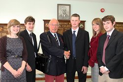 The students are congratulated by Mr Anthony Burgess, Chairman of the Harper Adams Development Trust