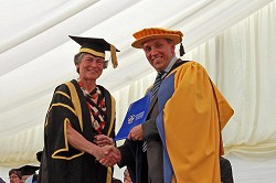 Justin King CBE receives his award from Alison Blackburn OBE, Chairman of the Harper Adams board of governors