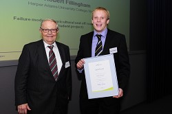 Helmut Claas presents Rob with his award
