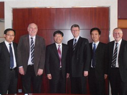 The Principal with President of Huazhong Agricultural University, Professor Deng Xiuxin (third from left), at the signing of the collaborative agreement
