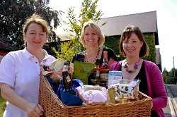 Harper Adams staff Clare Hutchinson, Sue Henderson and Joanna Gleeson with the hamper that will be raffled on Sunday