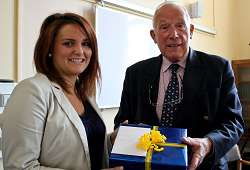 Tilly Lackie receives her gift from Trust Chairman Anthony Burgess