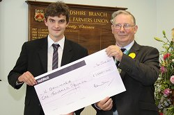 William Gallimore rceives his scholarship from Society President Robert Madders