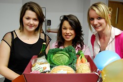 Anna Bird, Emily Goring and April Graham with the hamper