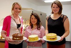 April, Emily and Anna prepare to serve up the cakes