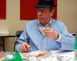 'Baconologist', Keith Fisher, tastes a sample