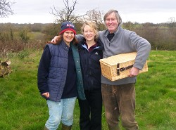 Stacey (centre) with hamper winners Richard and Helen Franklin