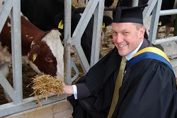 A Mole Valley Farmers' graduate at the dairy unit.