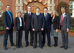 L-R Trevor Tyrrell, Beate Kral, Stephen McKean, Scholar Miles Metcalfe, Tom Fraser, Jane Broomhall and Richard Langley.