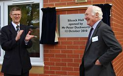 Principal of Harper Adams, Dr David Llewellyn, applauds Mr Peter Duckworth as he officially opens the new Silcock Halls.