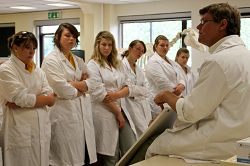 Students listen to senior lecturer Dr Jim Huntington as he teaches them about Farm Animal Reproduction