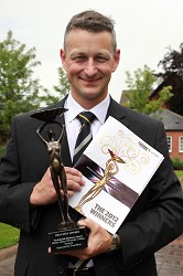 David Nuttall with the Catey Award