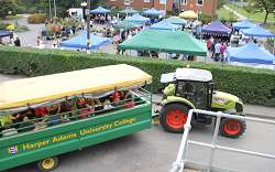The tractor trailer takes families around the campus at a previous farmer's market