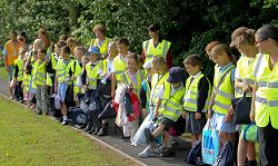 Children from St Peters Primary School in Edgmond get ready to set off for school on the walking bus.