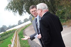 Dr David Llewellyn explains the value of the Natural England demonstration plots to Lord Smith.