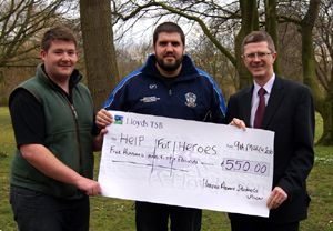 James Irving, left, Ben Harper, centre and Harper Adams Principal Dr David Llewellyn with the cheque for Help for Heroes