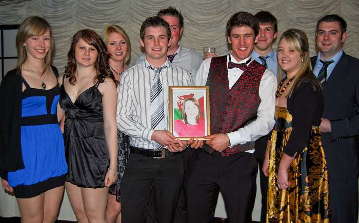 A group of 4th year students with a photo of their friend who couldn't make the event