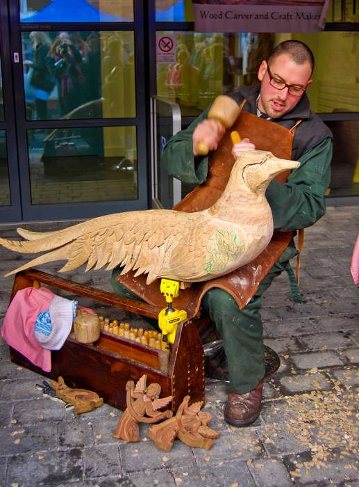 Wood carver and craftsman Alexander Jungmayr works on his rocking bird