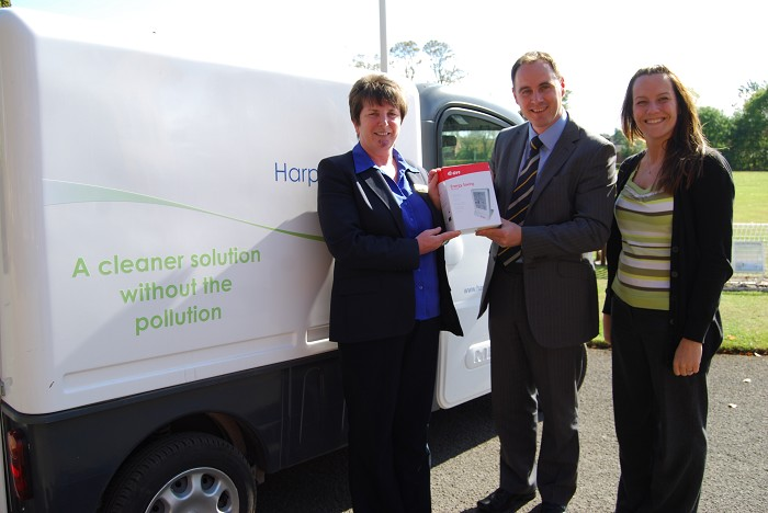 Margaret receives her energy monitor from Estates Manager, Paul Moran and Environment and Waste Management Officer, Karen Hughes