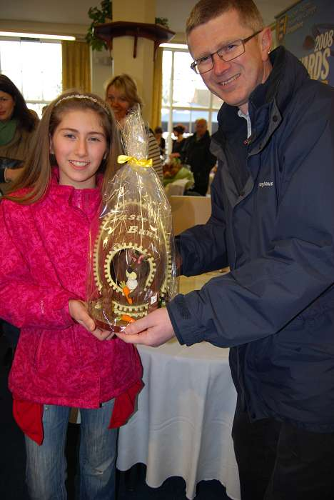 Winner of the Easter egg competition, Rebecca Longland with the Principal