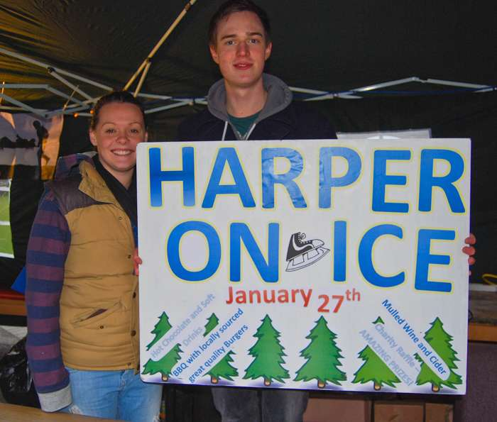 Emily Hayman and Zak Pichon-Flannery with the Harper On Ice sign