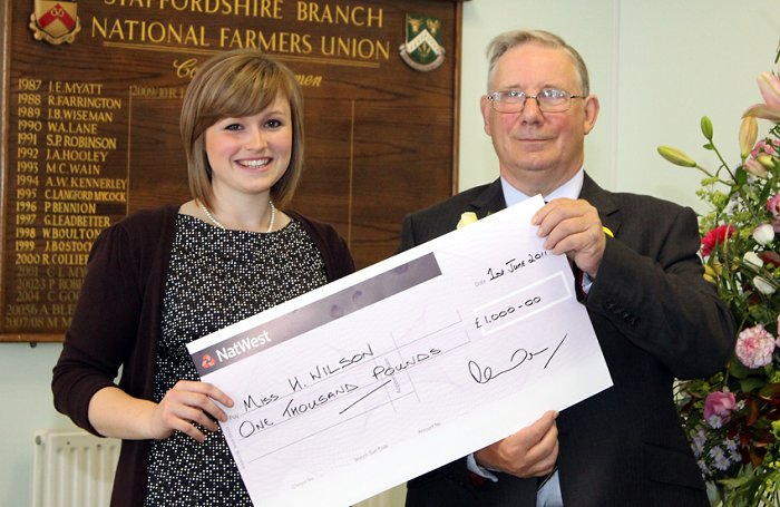Harriet Wilson receives her scholarship from Society President Robert Madders