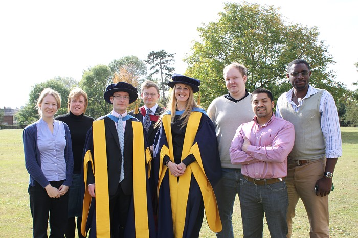 PHD graduates Andrew Watson and Gemma Charlton, with fellow research students