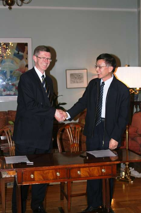 Dr Llewellyn completes the agreement with the Inner Mongolia Agricultural University