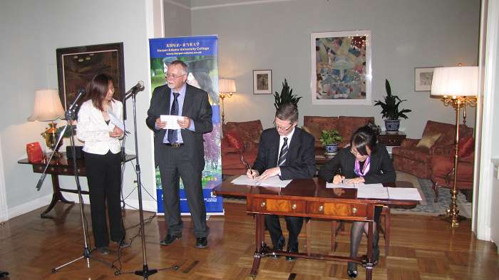 The formal signing ceremony at the Residence of the British Ambassador