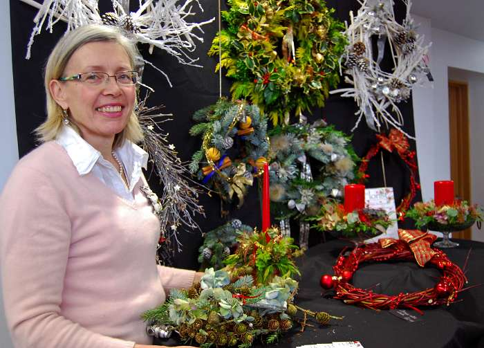 Florist Ruth Taylor with her locally sourced and hand-made Christmas wreaths