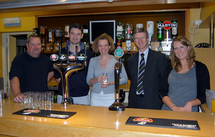 Bar Manager Barry Watkins, Student Union President Kevin Broe, Student Services Manager Bryony Hancock, Principal Dr David Llewellyn and Assistant Student Services Manager Becca Freer