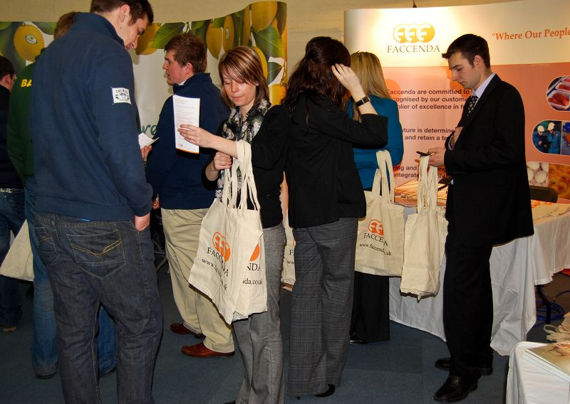 Students browse the stand and gather information.