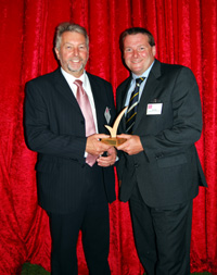 Bob Talbot and Scott Kirby with the BiTC Award