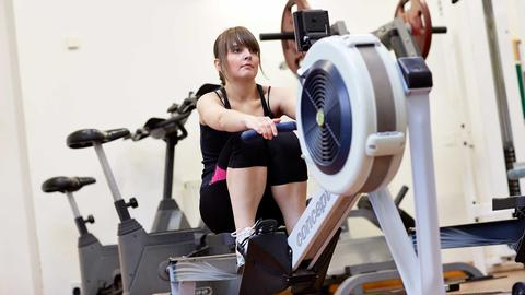 A student using the gym equipment